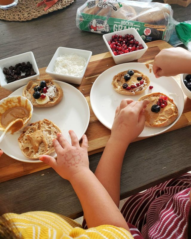 I often get asked how to get kids to make healthier choices. The easiest way is to get them involved! Today we had some extra time for breakfast so I set up the table so my girls can make their own fun creation! We used @daveskillerbread killersbread Rockin' Grains English Muffins and topped it with all-natural nut butter as the base. #ad Then the girls got creative with making their own faces and designs.  This makes a filling breakfast for the girls, especially because there are 20g of good quality organic whole grains in @daveskillerbread English muffins. The small rounds make it the perfect size for kids (and adults) to dig in!   #englishmuffin #breakfast #daveskillerbread #familyapproved #healthyeating #wholegrains #fibre