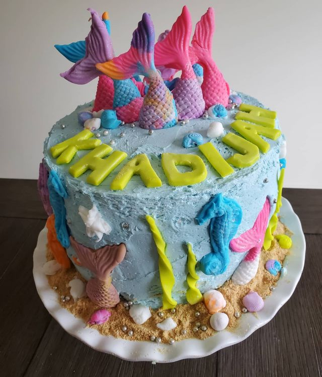 Introducing our Mermaid themed cake!  This year's cake request from my 6 year old was to do a *Mermaid* theme. I actually had a blast making the cake with Khadijah and her 3.5 year old sister because they were so helpful! They made all the fondant creatures and were so patient over the 2 days it took us to make it! Check out my stories to see the step by step process.  I hope through these cake making experience my girls build precious memories, learn the value of hard work and enjoying the outcome, and also develop a positive relationship with food.  You would think after making this cake they would be devouring it but instead they ate a slice ( + some fondant decals) and then thought about everyone else they could share their pretty cake with.  And that's what you call balance ❤.  . . . #cake #mermaidcake #foodblogger #foodie #birthdaycake #muslimahblogger