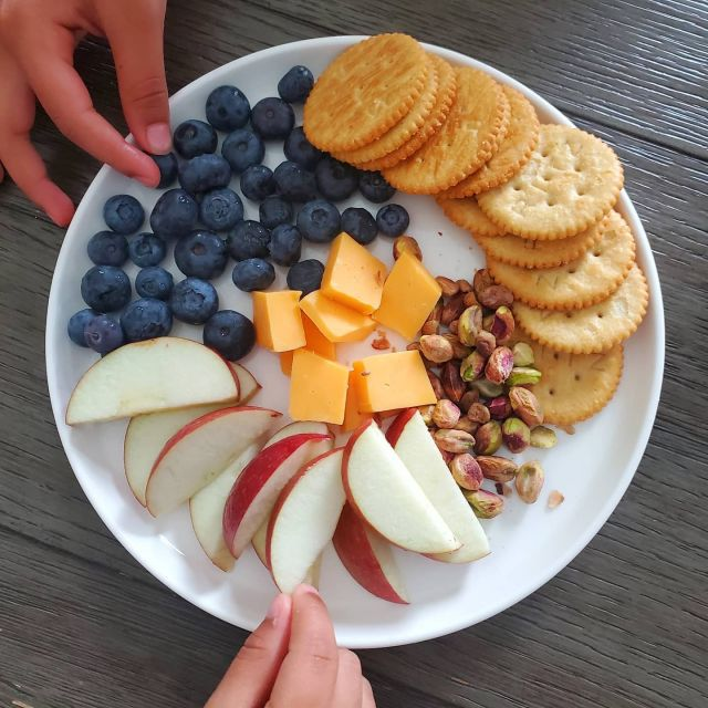 """It is a known fact that children have 2 stomaches - a limited size one for their meals and a mega-expandable one for snacks 😂.   It can be pretty frustrating to have kids barely finish their meals but ask for snacks all day!   However, snacks when done right can be a great way to fuel your little ones.   Here are some guidelines to help you as the parent take ownership of snacking:   1. Have set meal and snack times. For example, they cannot snack 20 minutes after their main meal. Atleast 1.5-2 hours works well for most kids. When kids get used to this timing, they are more likely to finish their meal plates. 2. Differentiate between snack foods and treat foods. This doesn't mean you should label unhealthy items as """"bad"""" or junk food. Instead, teach your kids about foods that will help them grow and become strong vs treat or sometimes foods.  3. Re-evaluate what is in your pantry. This often an easy to reach area for kids and packed with not the healthiest options. If it's in your home, you and your kids will likely eat it!  4. Have a designated day for treat foods. We usually do jummah treats and they have a treat with their grandparents too. 5. Don't police your child's food. If it's available at home and they are eating it, you should avoid using negative words to get them to eat less of these foods. Instead, you need to adjust what is available (i.e. healthier options and using more positive language).   The goal is to have a nourished child who has a positive relationship with food.   What are some things you do to help your child make healthier snack choices? What are your struggles when it comes to your kids' snack times? . . . #snack #healthy #healthykids #kidapproved #momapproved #healthymuslimah #muslimahblogger #healthymuslims #dietitian #nutritionist #nutritionblogger"""